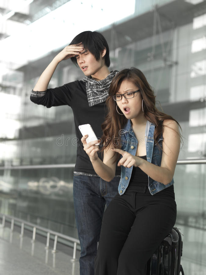 Chinese couple shocked over their flight plans stock photos
