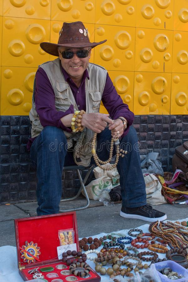 Chinese cowboy, seller in the flea market. Suifenhe, China 06.16.2017: Chinese cowboy seller in the flea market royalty free stock photos