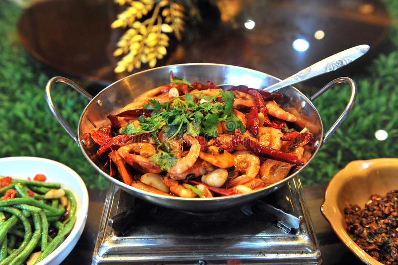 Chinese cuisine. A very popular Chinese food - Griddle Cooked Shrimp with Pepper royalty free stock image