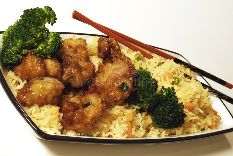 Chinese Cuisine. Food still life of Chinese General Taos with broccoli stock photos