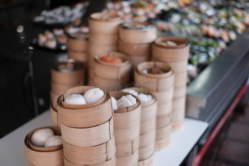 Chinese cuisine : Food in small bamboo basket prepare for dumpling, streamer to serv meal in asian restaurant. Dim sum : Chinese cuisine prepared as small bite royalty free stock images