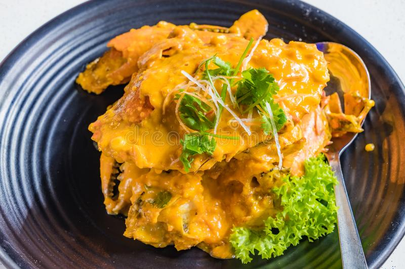 Chinese cuisine, Fried Crab with curry and salted egg yolk. Chinese cuisine, Fried Crab with curry and salted eggs yolk stock photos