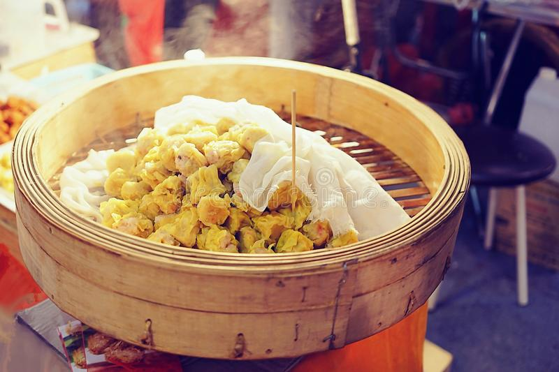 Chinese cuisine Shumai, hot and steamy dim sim or steamed Chinese dumplings were set in steamer basket. Pork Dumpling. With blurry background, chinese yumcha royalty free stock images