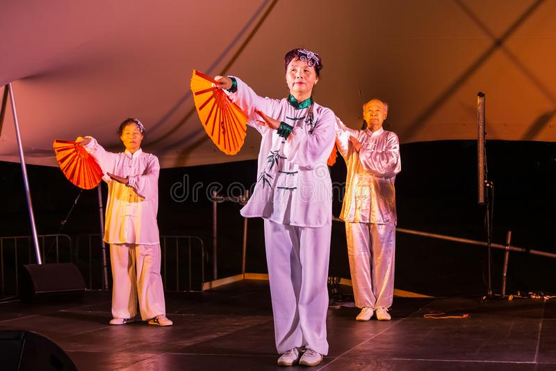Chinese dancers performing elegant fan dance royalty free stock image
