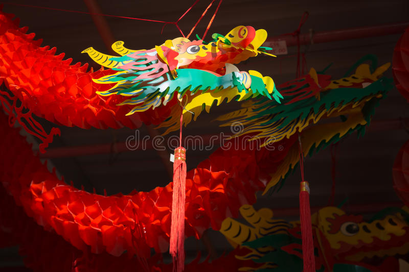 Chinese dancing dragon paper doll stock image