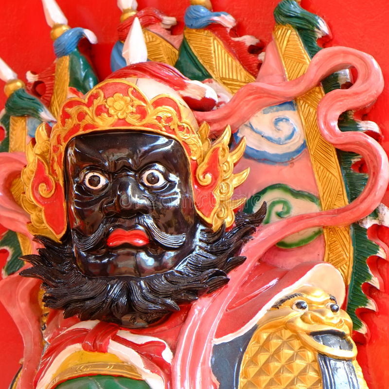 Chinese deity temple. With a sword standing at chinese temple door. Kuching, Sarawak state, Malaysia stock photography