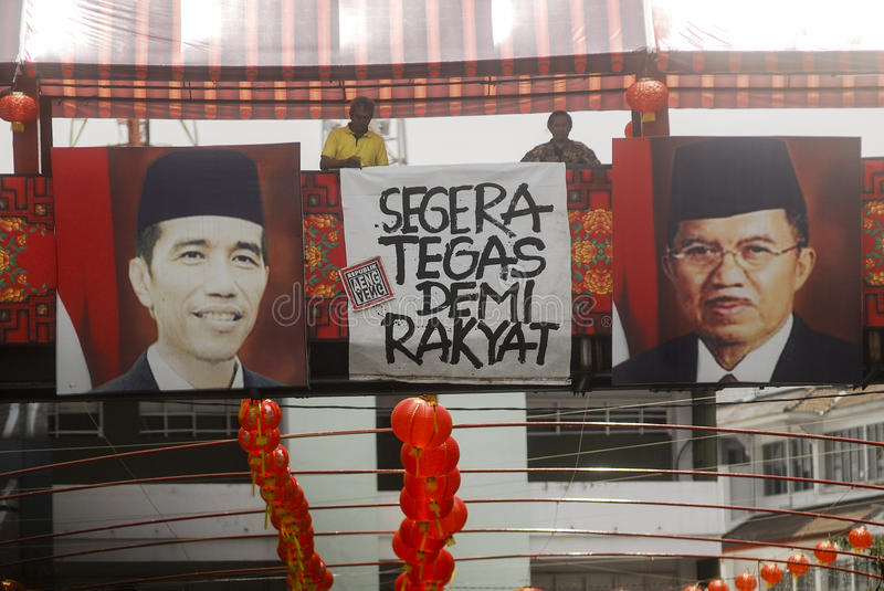 CHINESE DIASPORA. Picture of Indonesian President Joko Widodo and his Vice President Jusuf Kalla hung on a section of Sudiroprajan, a Chinese community zone on royalty free stock photos