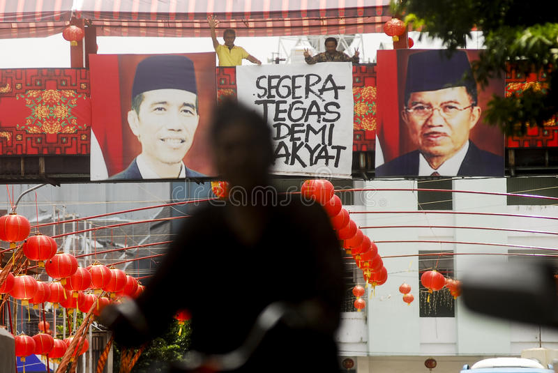 CHINESE DIASPORA. Picture of Indonesian President Joko Widodo and his Vice President Jusuf Kalla hung on a section of Sudiroprajan, a Chinese community zone on stock photos