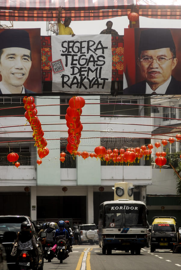 CHINESE DIASPORA. Picture of Indonesian President Joko Widodo and his Vice President Jusuf Kalla hung on a section of Sudiroprajan, a Chinese community zone on royalty free stock photography