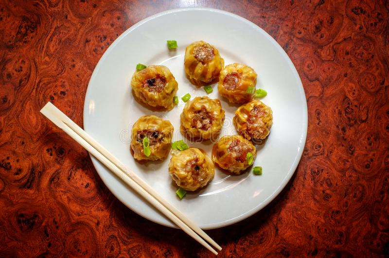 Chinese Dim Sum Dumplings. Delicious Chinese Dim Sum dumplings topped with scallions stock photos