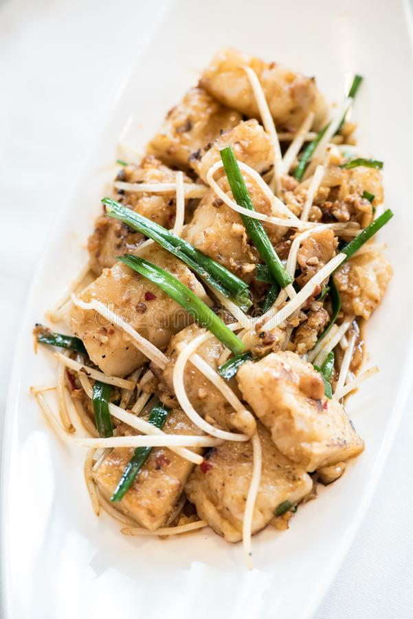 Radish Cakes. Chinese dim sum Grilled Radish Cakes smother in Chinese Barbecue Sauce Hoisin - Chinese groumet cuisine royalty free stock image