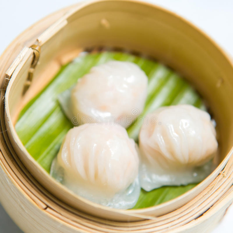 Chinese dim sum 'Hagao' in bamboo basket royalty free stock image
