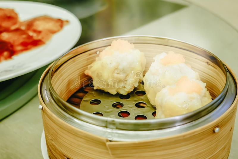 Chinese dim sum Shumai,a steamed dish to enjoy the Chinese gourmet cuisine. In restaurant stock image