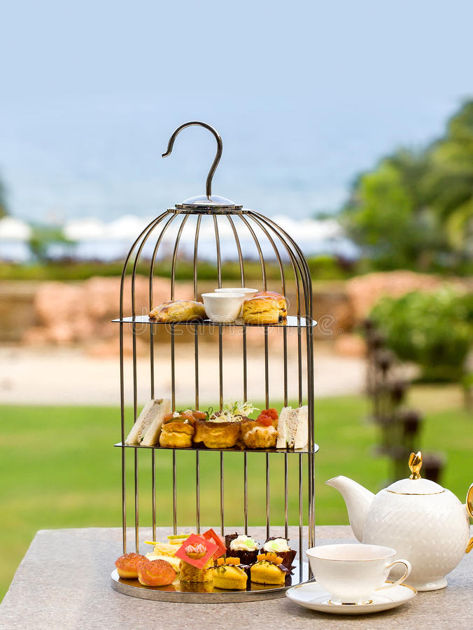 Chinese-dish cakes and pies put in birdcage. This dish iis the product of a five-star hotel in China, cakes and pies put in birdcage for afternoon tea stock photo