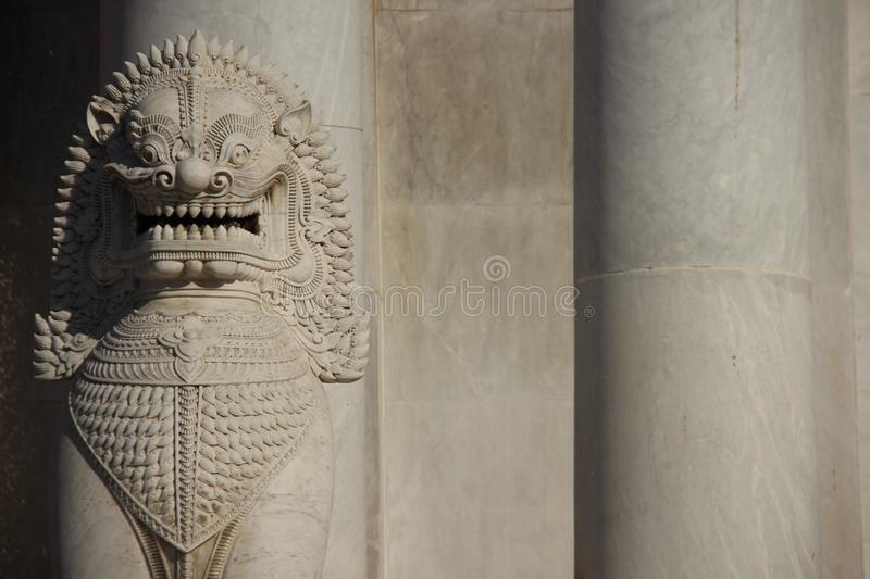 Marble Lion And Marble Pillars. Art. one marble lion and marble pillars in marble temple with warm sunlight in Bangkok Thailand stock images