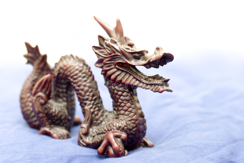 Chinese dragon. Over pale blue royalty free stock image