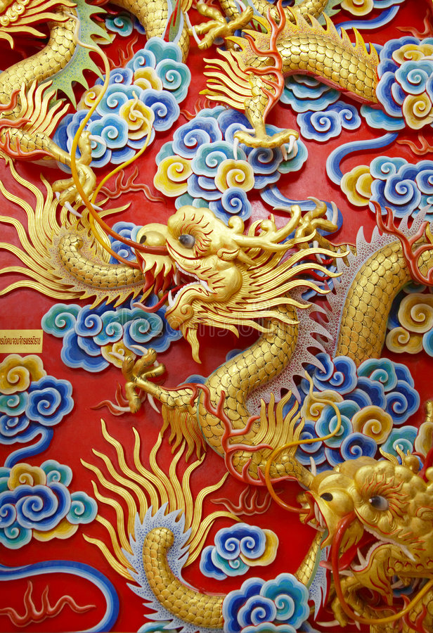 Chinese dragon. On red bachground royalty free stock photo