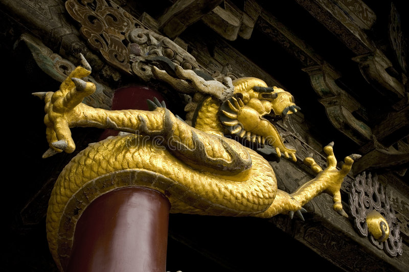 Chinese Dragon. On an ancient Chinese building stock images