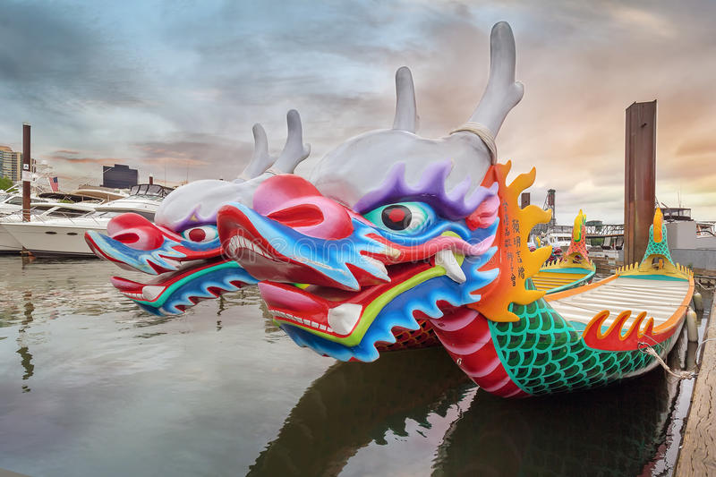 Chinese Dragon Boats Closeup. PORTLAND, OREGON - May 25, 2015: Chinese Dragon Boats docked at Willamette River in Downtown Portland Oregon at Sunset. These stock photos