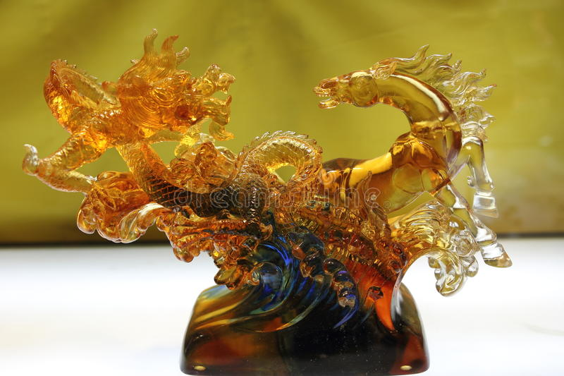 Chinese dragon and horse made by coloured glaze royalty free stock photography