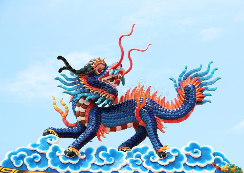 Chinese dragon. An image of dragon on a roof top of dragon Chinese temple. Dragon statue under blue dragon sky. Four dragons royalty free stock photo
