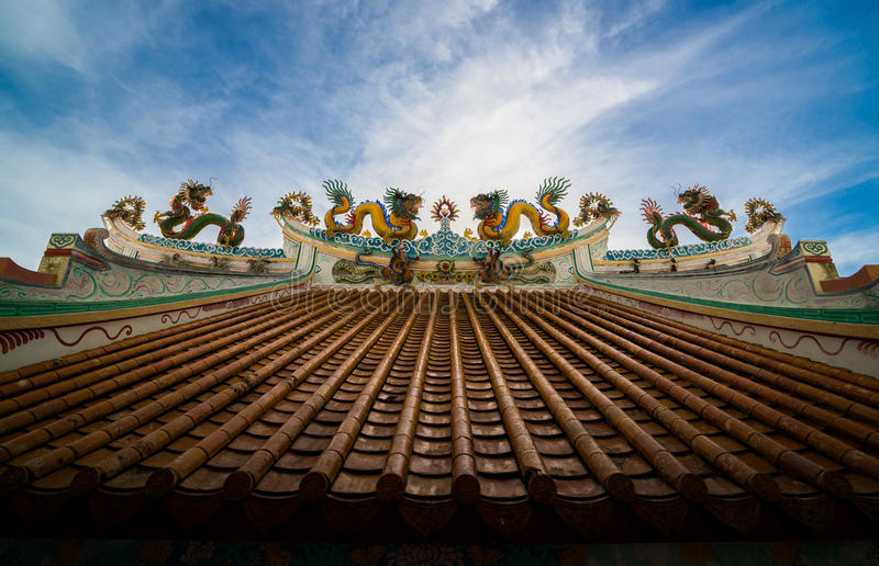 Chinese dragon. An image of dragon on a roof top of dragon Chinese temple. Dragon statue under blue dragon sky. Four dragons stock images