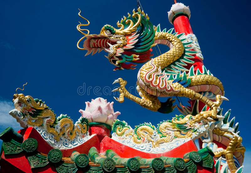 Chinese dragon on oriental temple roof. Chinese dragon on the roof in oriental temple in thailand stock photography
