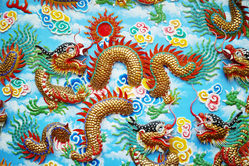 Chinese dragon sculpture on the wall stock images