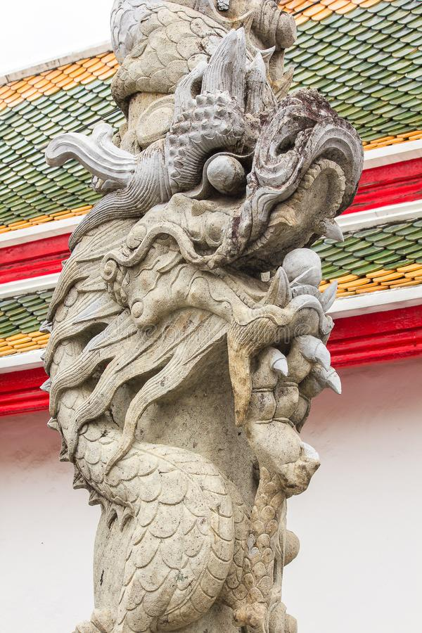 Chinese dragon-shaped carved stone in Thai temples. To decorate the place royalty free stock photo