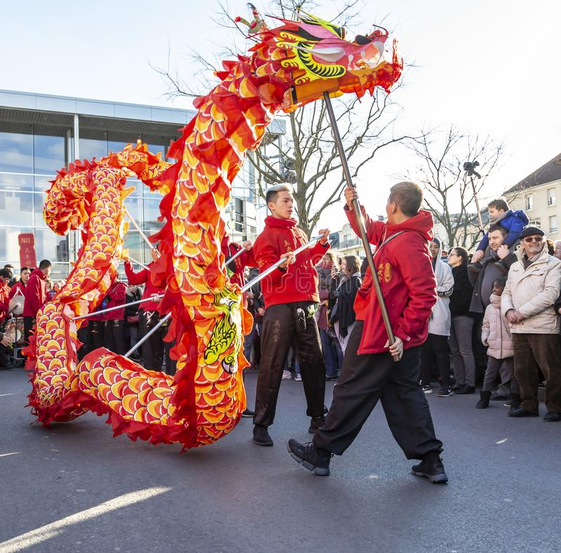 The Chinese Dragon - The Year of the Dog 2018. Noisy-le-Grand, France - February 18,2018: Group of performers moving the Dragon during the Chinese New Year stock photo