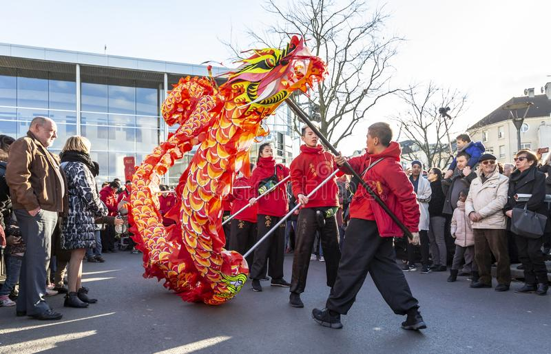 The Chinese Dragon - The Year of the Dog 2018. Noisy-le-Grand, France - February 18,2018: Group of performers moving the Dragon during the Chinese New Year royalty free stock photo