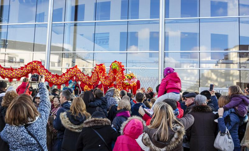 The Chinese Dragon - The Year of the Dog, 2018. Noisy-le-Grand, France - February 18,2018: The Chinese Dragon seen from the crowd of spectators during the royalty free stock photos