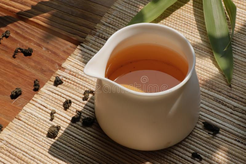 Chinese tea leaves and tea drinks on rustic wooden table royalty free stock photo