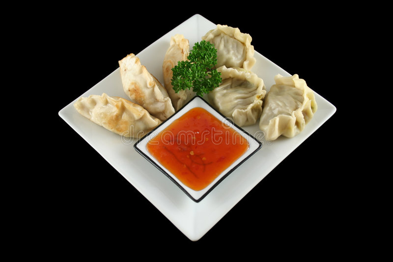 Chinese Dumplings 1. Delicious fried pork and vegetable Chinese dumplings ready to serve stock images