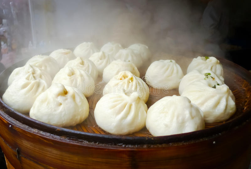 Chinese dumplings. Being steamed on the traditional bamboo pan royalty free stock photo