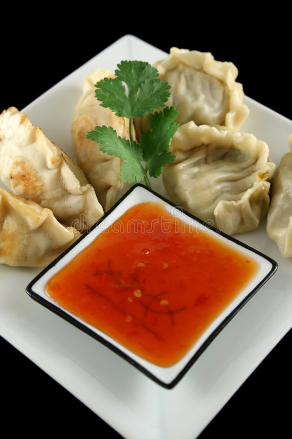 Chinese Dumplings 6. Delicious fried pork and vegetable Chinese dumplings ready to serve stock photo