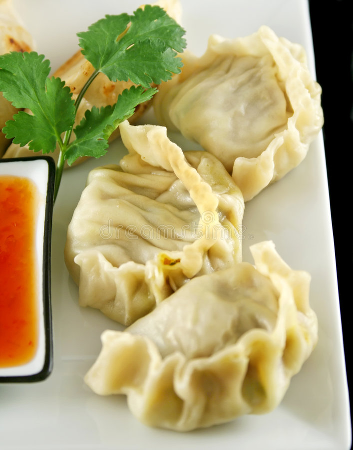 Chinese Dumplings 7. Delicious fried pork and vegetable Chinese dumplings ready to serve stock images