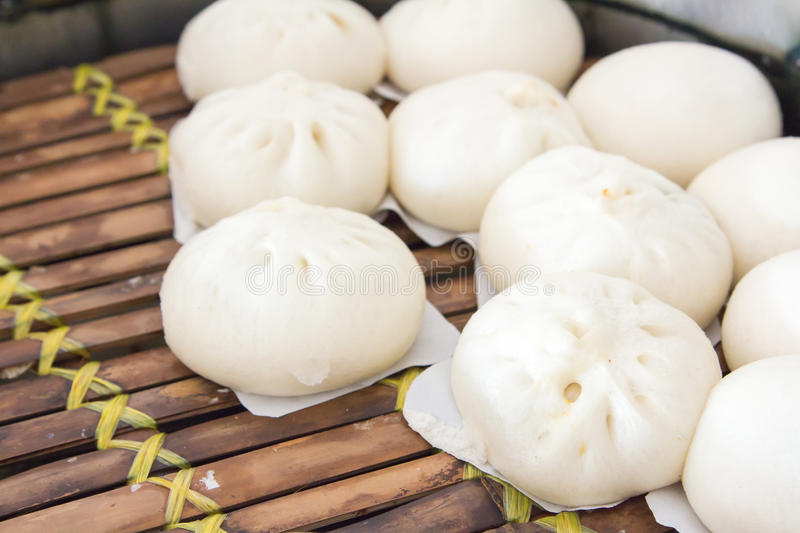Chinese dumplings being steamed on the traditional bamboo pan. royalty free stock image