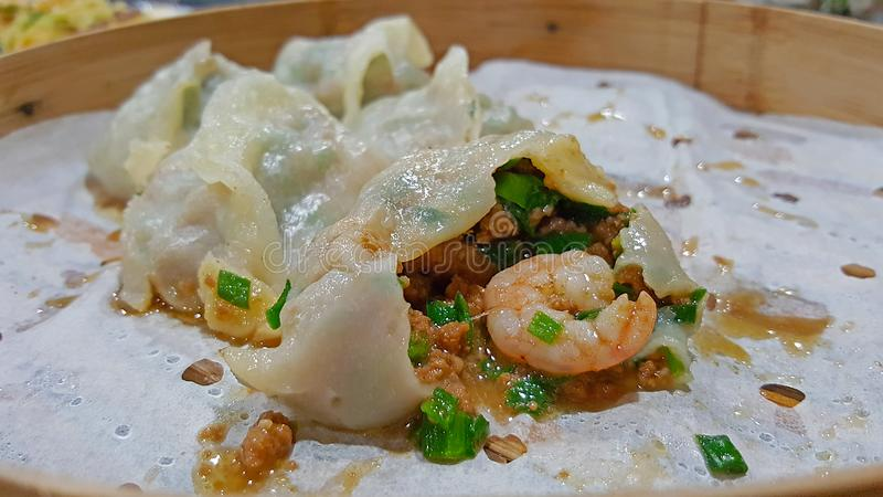 Chinese dumplings Dim Sum with shrimp, meat and greens stock images