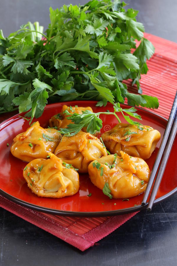 Chinese dumplings - dim sum. With sour-sweet sauce royalty free stock images