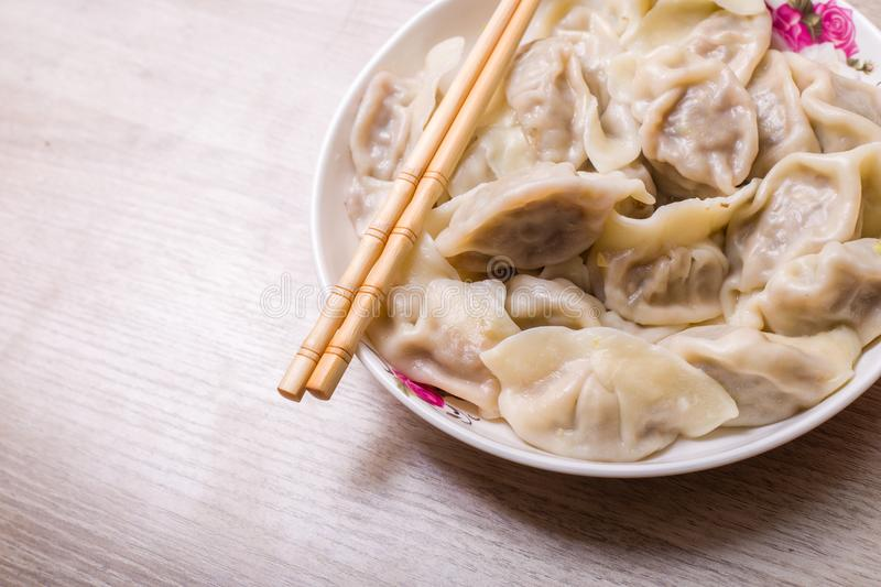 Chinese dumplings. Jiaozi, traditional food for Chinese New Year festival royalty free stock images