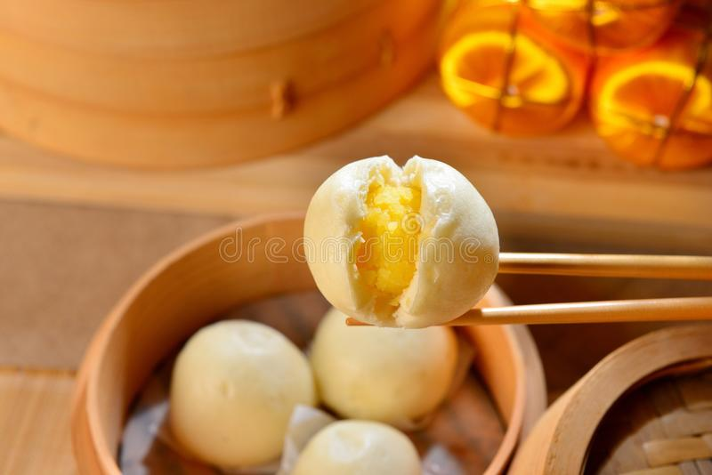 Chinese dumplings with yellow egg inside on bamboo tray. Deliciously royalty free stock photo