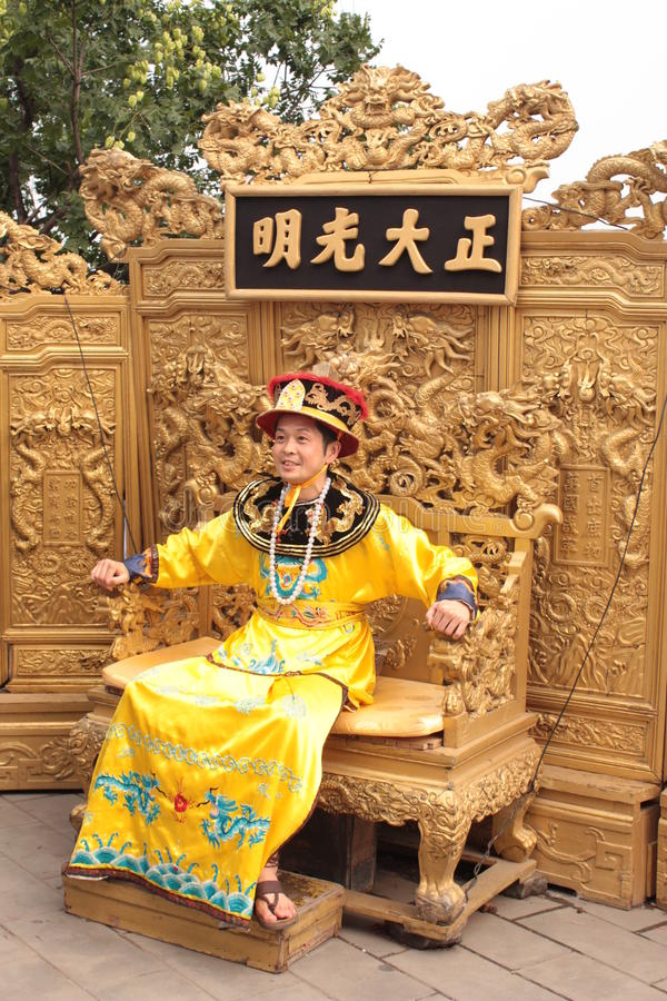 Chinese emperor is siting on the throne stock image