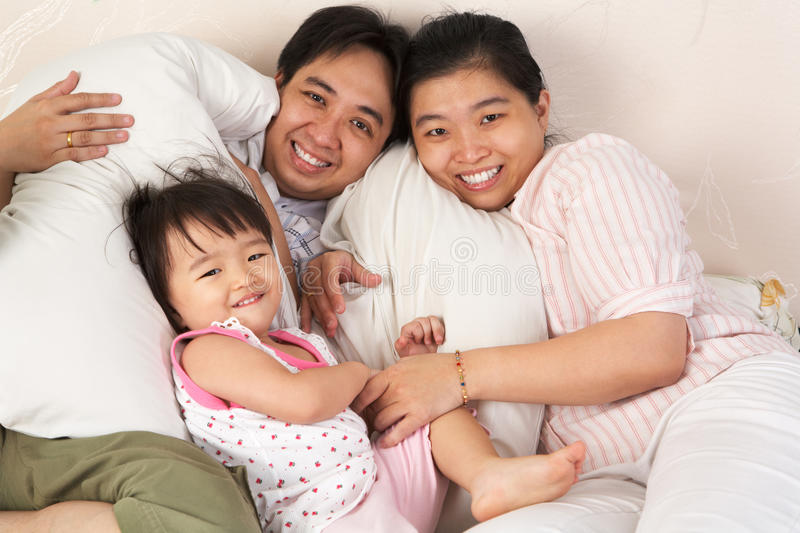 Download Chinese Family Having Fun On Bed Stock Image - Image: 14669709