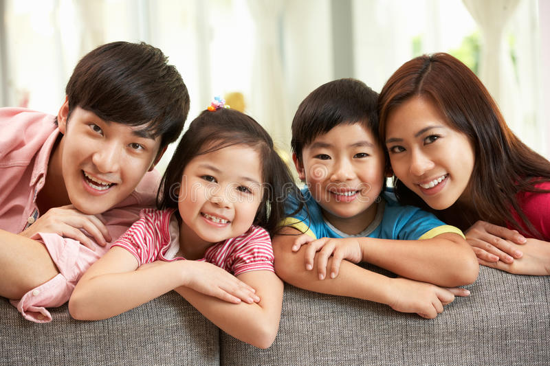 Chinese Family Relaxing On Sofa At Home royalty free stock images
