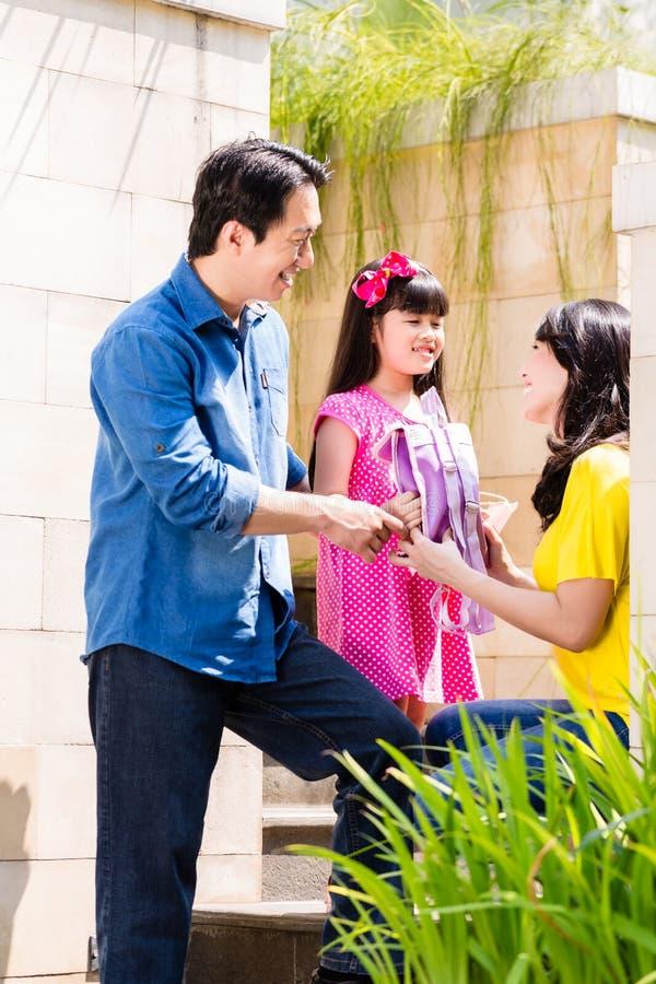 Chinese Family sending girl to school stock photo