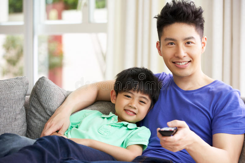 Download Chinese Family Watching TV On Sofa Together Stock Photo - Image of male, waist: 26246112
