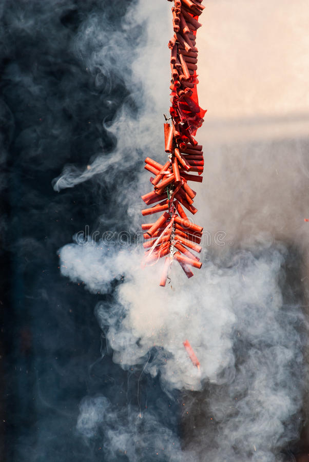 Chinese firecracker. Description: A firecracker is a small explosive device primarily designed to produce a large amount of noise, especially in the form of a royalty free stock photo