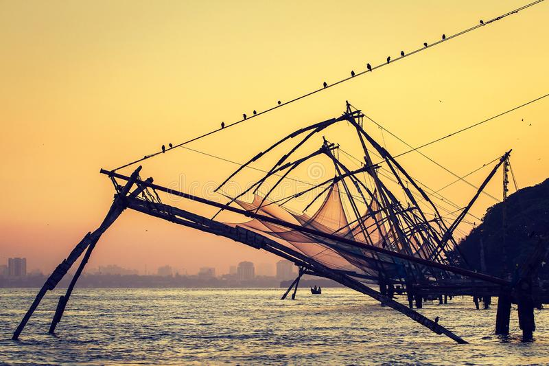 Chinese fishing net at sunrise in Cochin Fort Kochi, Kerala stock photos