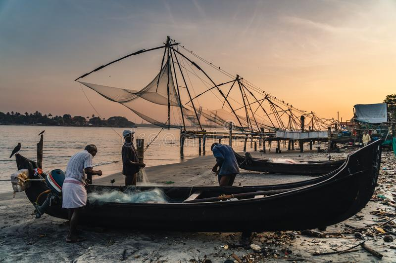 Chinese fishing nets during the Golden Hours at Fort Kochi, Kerala, India sunrise team royalty free stock images